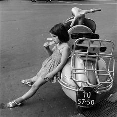 Girl with ice lolly by a Vespa scooter, Amsterdam, 1957 Photo by Philip Mechanicus