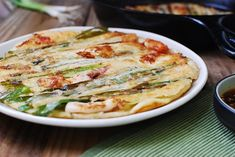 Pajeon is a Korean savory pancake made with scallions. Pa means scallion, and jeon means pan-fried battered food. A popular variation of pajeon is haemul pajeon, which is made with seafood. Pajeon is one of Koreans' all-time favorite snacks or appetizers to share when gathered around the table with friends and family. Everyone always loves …