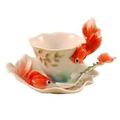 "Gold fish design sculptured porcelain cup, saucer & spoon. Hand painted. 4""H."