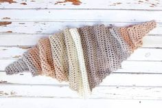 Toss on this modern crochet triangle scarf to head out to the desert, the mountains...or just the grocery store. This free Caron Cakes crochet pattern takes all the stress out of choosing colors because the skein does it for you! Excellent, cheap crochet gift idea! Color = Buttercream.