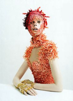 """An otherworldly mermaid effect on Frida Gustavsson in """"Jewel in the Crown"""" US Vogue May 2012 is conjured with a shell-encrusted full-length dress and hand jewelry by Alexander McQueen. Coral headpiece was created by Julien d'Ys. Photographed by Tim Walker and Styled by Phyllis Posnick."""