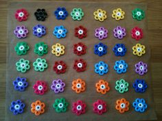 Hama Flowers by Majjan  1. Create your flowers 2. Put them in own on 200 degrees celsius for 3-5 minutes