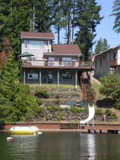 Shelton Lakehouse, 300 per night, 2000 sq.ft, 600 square foot deck w/ BBQ and plenty of seating, 300 square foot dock with water slide, paddle boat and row boat, and outdoor firepit-fun for smores and campfire stories! Great trout fishing from the dock in beautiful clean, swimming lake.high chair(2), playpens, toys and board games, water floats, dvd/videos, lots of life vests in all sizes, and every kitchen gadget needed.Large back lot area for extra parking.