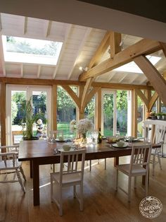 Green Oak Framed Extension Dining Room Interior. By Carpenter Oak