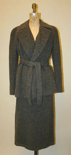 Calvin Klein: He had a very simple and pure line of clothing. He founded his line in 1968 but this particular piece is from 1996 and is made of wool and nylon. He started with a coat shop in New York City.