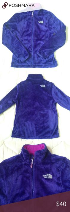 Women's Fleece Jacket Super soft fleece jacket that will keep you warm and cozy. Soft silken high-pile raschel fleece. Cozy oversized collar. Relaxed fit. Hardface stretch fabric at cuff. Two secure-zip hand pockets. Color is bluish/purplish almost like a dark periwinkle color and lined with magenta detail inside. Only used a handful of times. In very good condition. The North Face Jackets & Coats