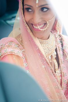 Beautiful vintage Sikh bride in pink lehnga with pearl naath and pearl jewelry set