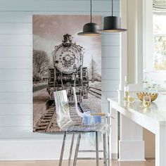 The statement-making power of our Freight Train Artwork is spectacular. This is a unique piece of artwork, with an overall metallic, silver-toned treatment    for a more industrial-contemporary look. This updated version of a timeless train image would look great in an updated industrial or rustic chic living    space, an office, or home bar/entertainment area or media room. Also impactful in an entryway. The photographic image is screenprinted on canvas and given    a brushed finis...