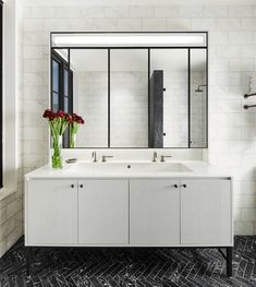 hanging white vanity with large mirror