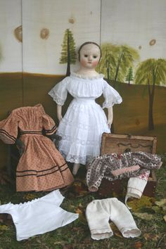 Reproduction Izannah Walker doll with a pressed cloth head and her wardrobe.  Hand painted back ground in the style of muralist Rufus Porter.