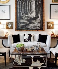 The wood, greenery, gold accents warm up the black and white which can easily be too cold in feel--lovely arrangement