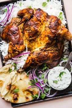Roasted Tandoori Chicken by The Modern Proper Warm spices like ginger, turmeric, cinnamon and cumin mixed with yogurt make the marinade for this simple whole tandoori roast chicken. Whole Roasted Chicken, Stuffed Whole Chicken, Recipe For Raita, Frango Tandoori, Tandori Chicken, Rosted Chicken, Cooking Recipes, Healthy Recipes, Game Recipes