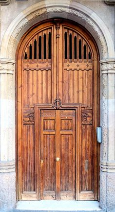 Doors of Casa Torres Germans III, in L'example, Barcelona, Spain - photo by Arnim Schulz, via Flickr;  built in 1908;  The architect was Jaume Torres i Grau.