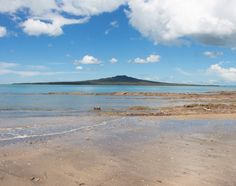 Traveling New Zealand? Check out St Leonard's Beach! One of the prettiest beaches in Auckland! Pretty Beach, New Zealand Travel, Auckland, Beaches, Traveling, Mountains, Water, Check, Outdoor
