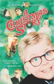 A Christmas Story.  When I was little I would get up really early before everyone else, see what Santa brought, then go watch this movie.