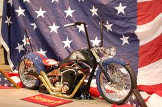 Marine motorcycle displayed in front of a USA flag