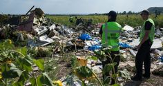 This photo shows the MH 17 recovery team still investigating the crash site.