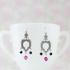 Vintage keyhole-style earrings accented with contemporary fuchsia and jet black genuine Swarovski crystals