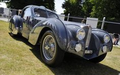 1936 Bugatti Type 57S Atlantic One of just four Atlantics built, this stunning car was actually badly damaged in a collision with a train on an unmanned rail crossing in 1955. Not that you'd ever guess now, such is the level of detail that went into the restoration