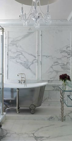 An example of how it might work having marble covering the floor and the walls. Big bathroom