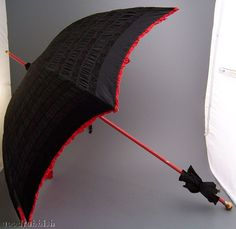 Black shirred parasol with red shirred lining, late 1880's-early 1890's