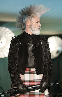 Who says punk is for kids? A handsome elderly model sports grown out beard and sculpted Spartan mohawk hairstyle