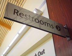 Architectural Signage - Priority Architectural Graphics: The restroom sign is… Directional Signage, Wayfinding Signage, Signage Design, Library Signage, Architectural Signage, Exterior Signage, Church Signs, Environmental Graphic Design, Box Design
