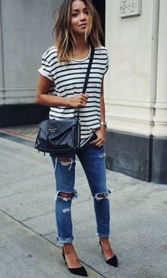 She is loving her stripes. Loose striped tunic with round neckline and rolled short sleeves. Jeans are really ripped. Love the destruction :). Navy cross body bag and black low heeled slingbacks. She is stylin'. Style Planet