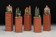 Like the idea of the risers for little houses.just as it is would make a nice center piece for a long table. Clay Houses, Ceramic Houses, Miniature Houses, Ceramic Clay, Ceramic Pottery, Art Houses, Clay Crafts, Home Crafts, Pottery Houses