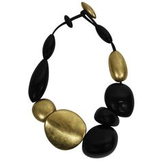 Gerta Lynggaard Lucite and Gold Lacquered Necklace | From a unique collection of vintage beaded necklaces at http://www.1stdibs.com/jewelry/necklaces/beaded-necklaces/