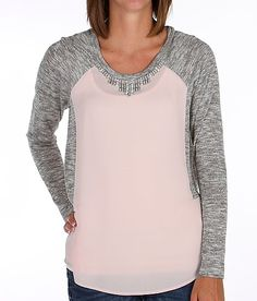 Like this top, just wish it didn't have the stupid rhinestones on the collar.