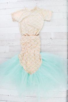 Learn how to make a mermaid tail skirt! It's perfect for a DIY handmade costume or just dress up time, and it's easy to run and play in! My daughters love dressing up and do any chance they can. It makes Halloween costumes extra exciting! Currently one of my daughters only wears dress-ups as her clothing. I love adding pieces that they can play in like this mermaid tail skirt! It would be so fun to switch up the colors and the knit scale fabric.