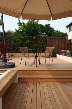 Or will the deck stairs be like this? Photo also shows builtin garapa/oak benches, which we could reference if we built in the daybed.