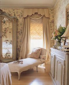Vintage furniture and fireplace, natural curtain fabrics, fresh flowers, wallpaper with floral prints and upholstered furniture for living room decor in Provencal style