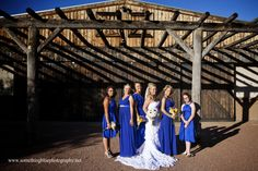 Star Dance in Tucson, Arizona, ceremony site, Bride with Bridesmaids, mountain background and barn. www.somethingbluephotography.net