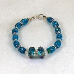 Crystal Blue Faceted Beaded Bracelet #728 $14.00 http://www.artfire.com/ext/shop/studio/HCLTreasures
