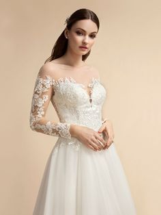 For the bride looking for modern and traditional details, style will have you falling in love again. And with embroidered lace appliques throughout the gown, this dress will look beautiful for all types of brides. Wedding Dress Sleeves, Long Sleeve Wedding, Wedding Dress Styles, Beaded Wedding Gowns, A Line Bridal Gowns, Spring Wedding Inspiration, Sophisticated Bride, Bride Look, Modern Traditional