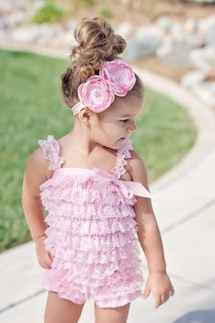 baby pink ruffle romper with matching headband...I bought something similar for A off zulily and I think I'm going to try to find a headband like this to go with it! Adorable!!