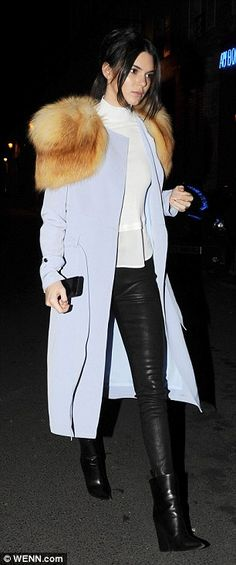 Fabulous in fur: The model of the moment stood out from the crowd in her striking coat