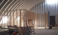 Four-months after the slab was poured this Quonset hut project moves inside