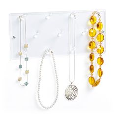 Hang your necklaces on our 11-Peg Acrylic Necklace Rack and your collection will be kept organized and tangle-free.  Save time in the mornings when this rack is mounted to your closet wall - you can select the necklace to coordinate with your outfit!