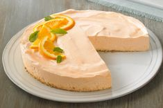 Orange Dream Cheesecake recipe - this cheesecake is absolutely delicious, and all who try it will ask for more.  Not nearly as rich as a typical cheesecake, it actually provides a very light, fresh end to a meal.