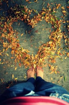 Fall into Love with Autumn... perhaps have the feet of family members surround the heart.