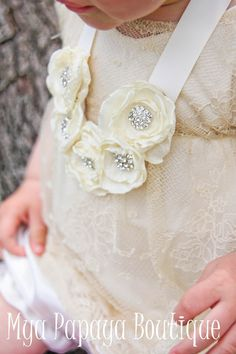 Handmade with handcrafted silk rosettes, beautiful rhinestone centers and adjustable soft satin ribbon neck ties. Necklace shown in cream, but other rosette, ribbon and rhinestone color selections available. %100 customizable. MEMBER - MyaPapayaBoutique