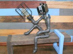 Hey, I found this really awesome Etsy listing at https://www.etsy.com/listing/237365234/robot-lamp-pipe-lamp-industrial-decor