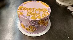 A whimsical pattern of dots and swirls covers this birthday cake.