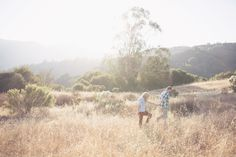 Photography: This Love Of Yours Photography LLC  Read More: http://www.stylemepretty.com/california-weddings/saratoga/2014/02/21/sunset-field-engagement-at-mountain-winery/