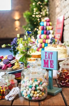 Alice in Wonderland decorations: Add a touch of the Mad Hatter's tea party to your wedding day with this cute sign, encouraging your guests to tuck into the sweet treats on offer. Image | Lisa Carpenter Photos