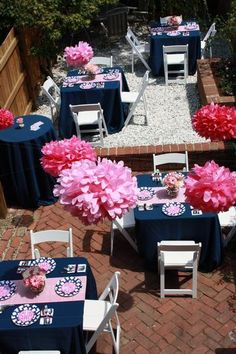 Reminds me of our wedding shower - floor length blue linens and pink poofs! :)