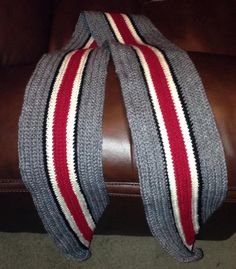 Ohio State helmet scarf, $25.00  Approximately 6 ft long, 8 in wide. Colors used are charcoal gray, black, cream, and burgundy.